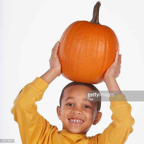 Boy with Pumpkin on His Head