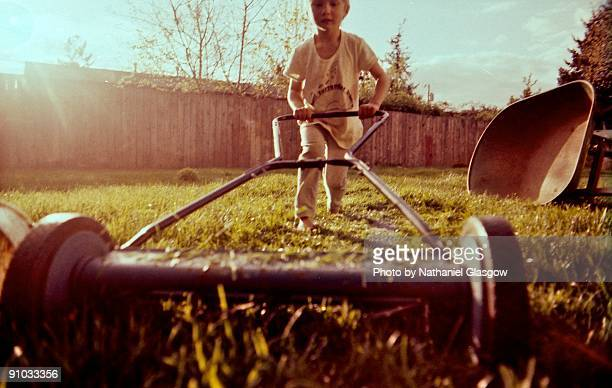 Boy with push mower.
