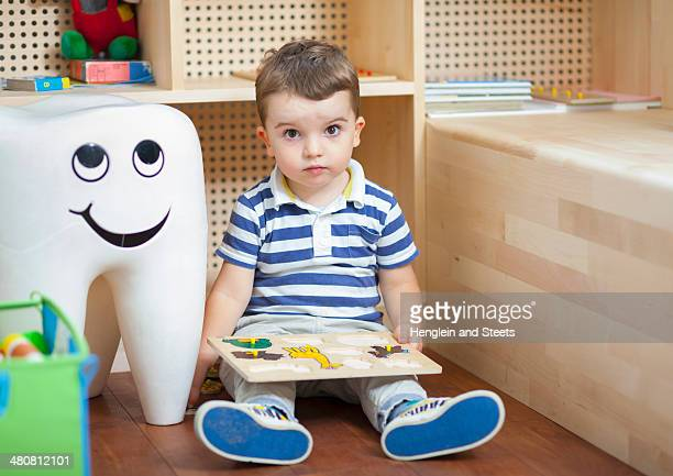 Boy with puzzle at dentists