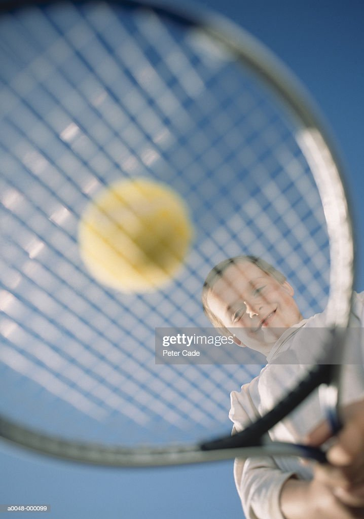 Boy with Racket and Ball : Stock Photo