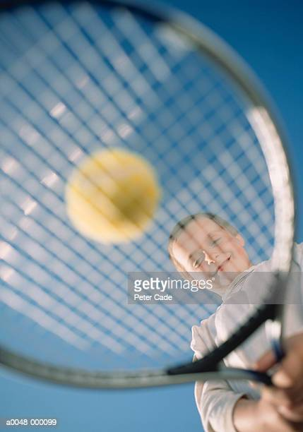 Boy with Racket and Ball