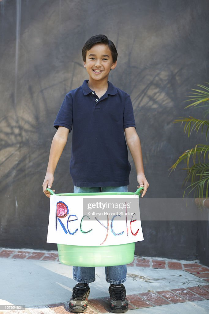 Boy with recycle sign and bin : Stock Photo