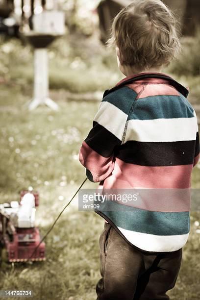 Boy with remote control car