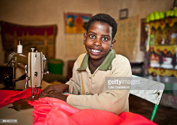 Boy with sewing machine.