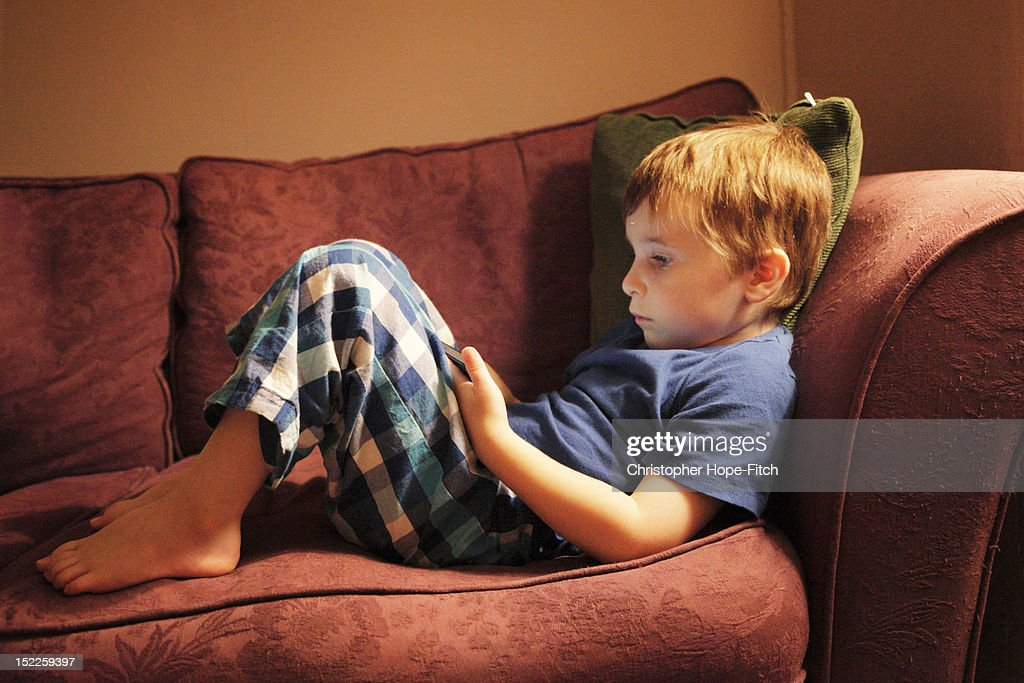 Boy with smartphone : Stock Photo