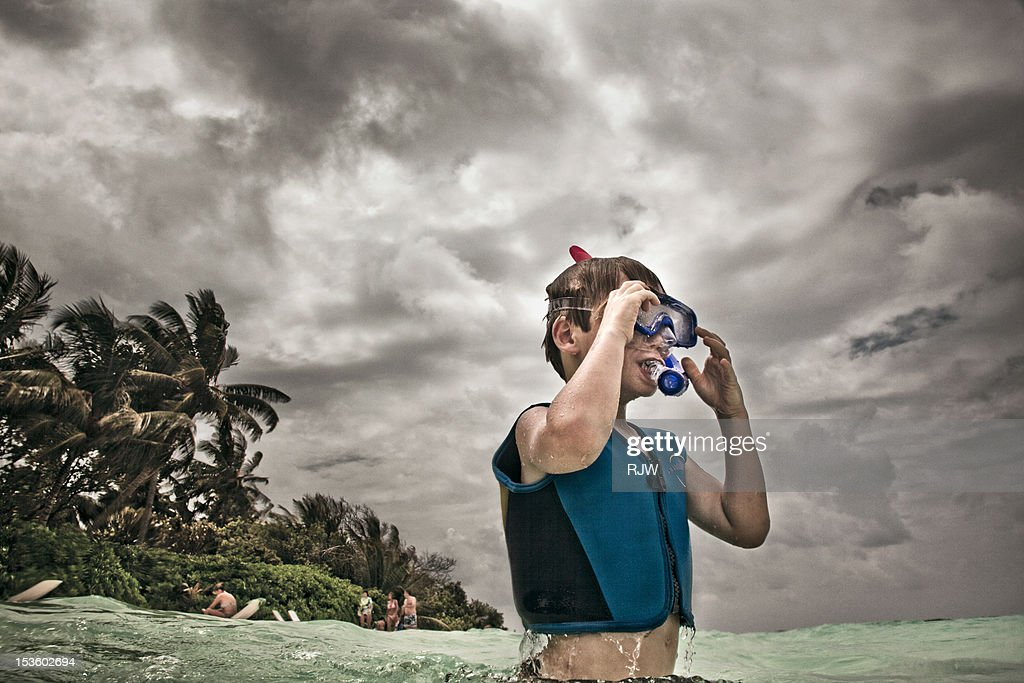 Boy with snorkel in ocean : Stock Photo