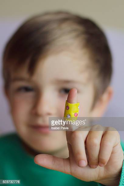 Boy with sticking plasters on finger