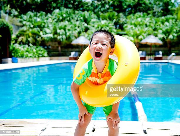 boy with swimming tube