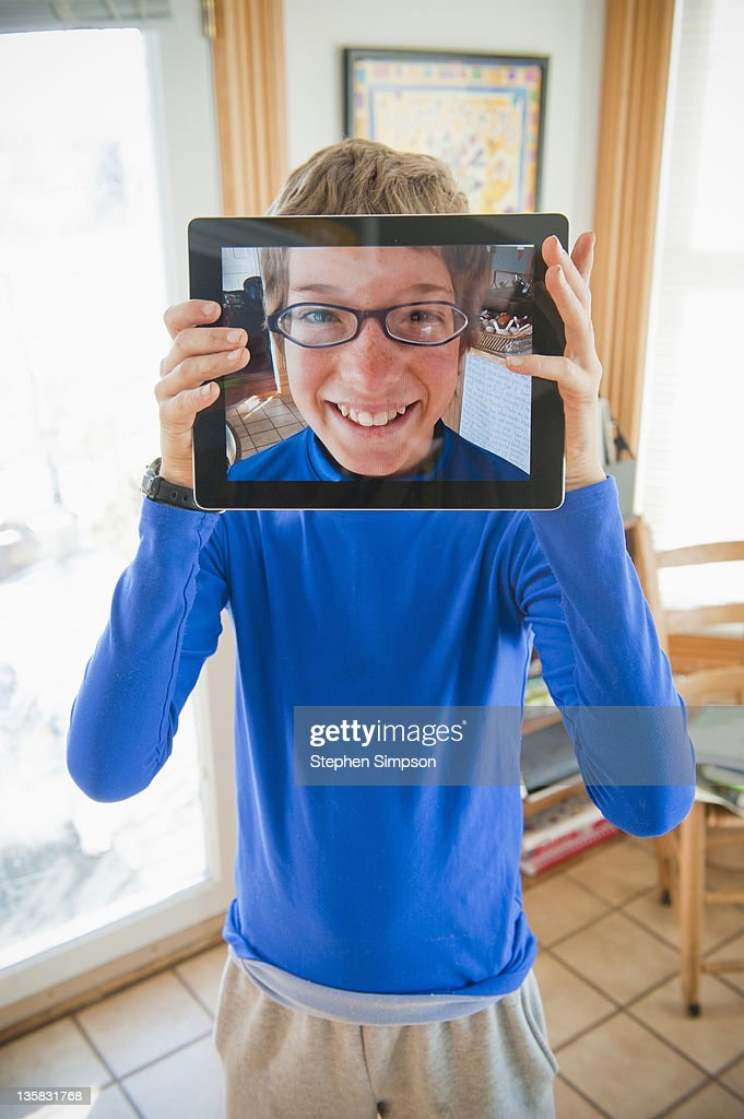 boy with tablet computer self portrait : Stock Photo