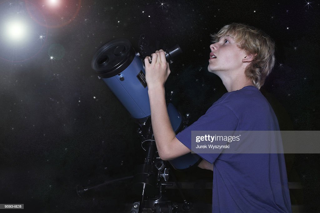 Boy with telescope looking at stars : Stock Photo