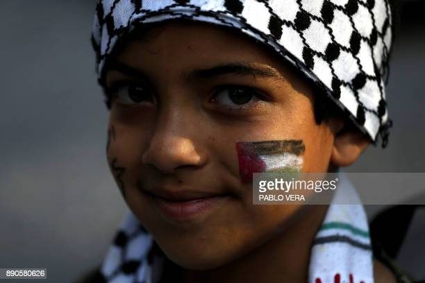 A boy with the Palestinian flag painted on his face takes part in a protest against US President Donald Trump's recognition of Jerusalem as the...