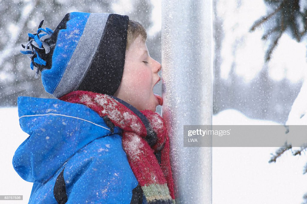 Boy with Tongue Stuck to Pole, in Wintertime