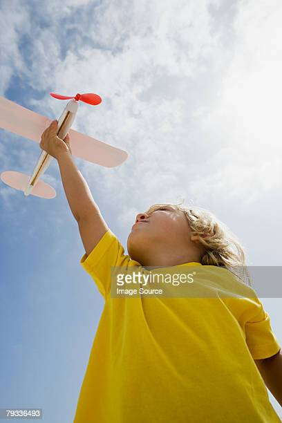 Boy with toy aeroplane