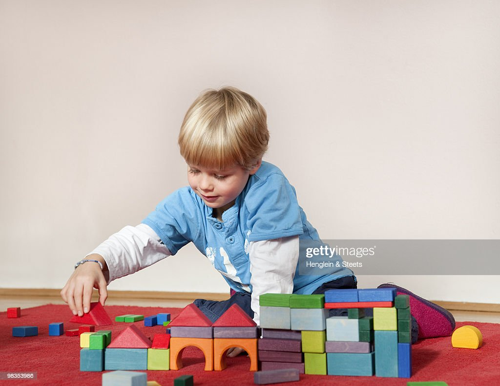 boy with toy building blocks : Stock Photo