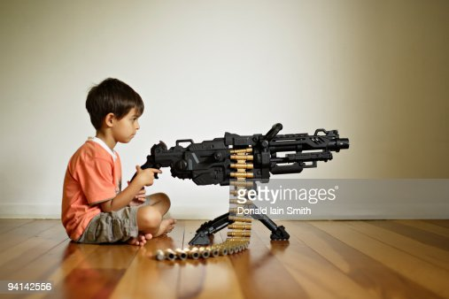 Boy with toy machine gun