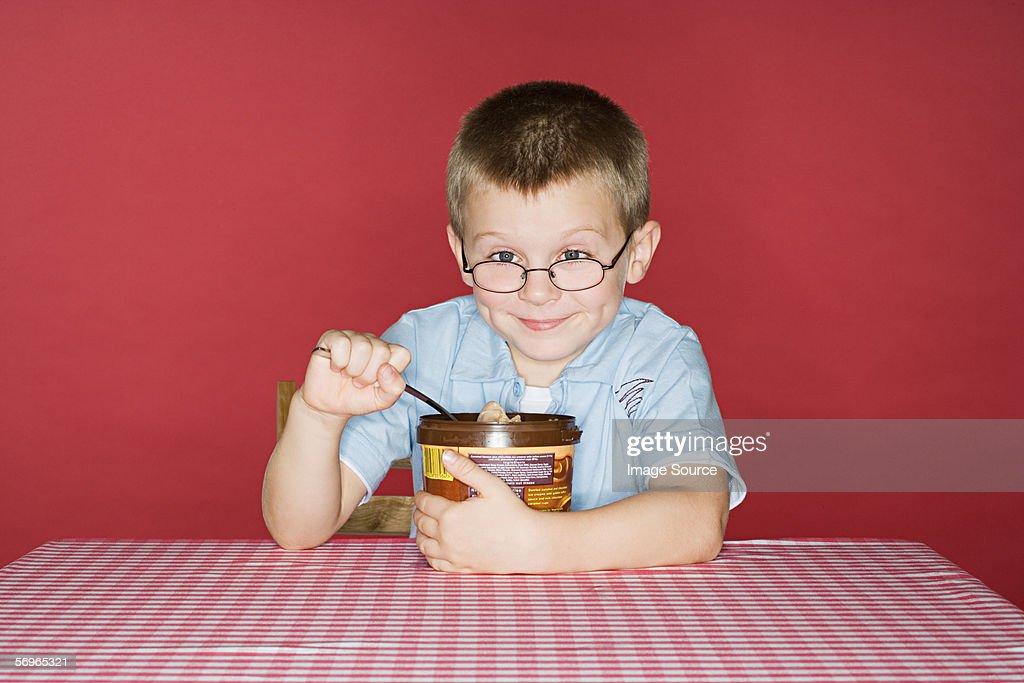 Boy with tub of ice cream : Stock Photo