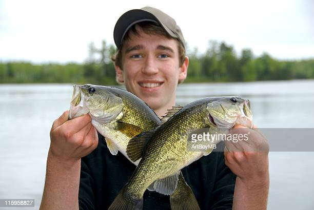 Boy with two Largemouth Bass