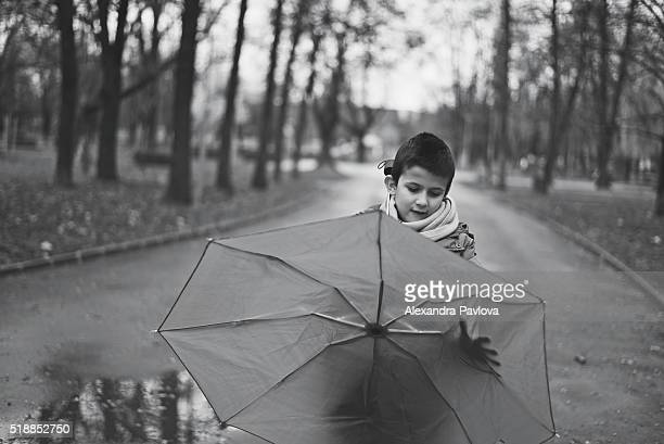 boy with umbrella after rain