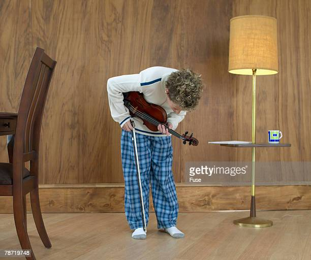 Boy with Violin Taking a Bow