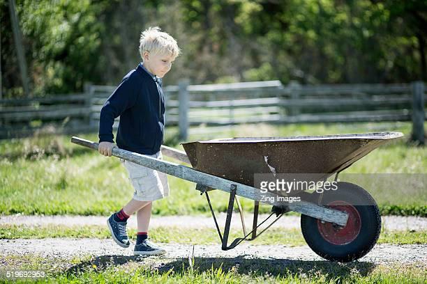 Boy with wheelbarrow