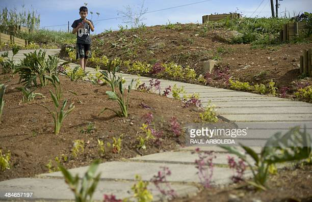 A boy wlaks in the Commune 4 Moravia shantytown in Medellin Antioquia department Colombia on April 9 2014 Moravia which in 30 years accumulated tons...