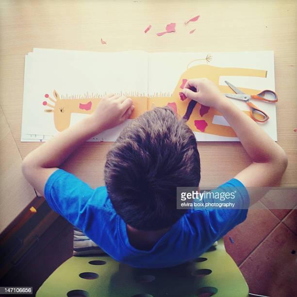 Boy working on craft book