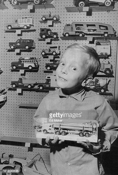 DEC 6 1967 DEC 9 1967 'Boy would I like to find this under the tree' Vince Gavito holds Matchbox truck a topselling toy item this year He's a son of...