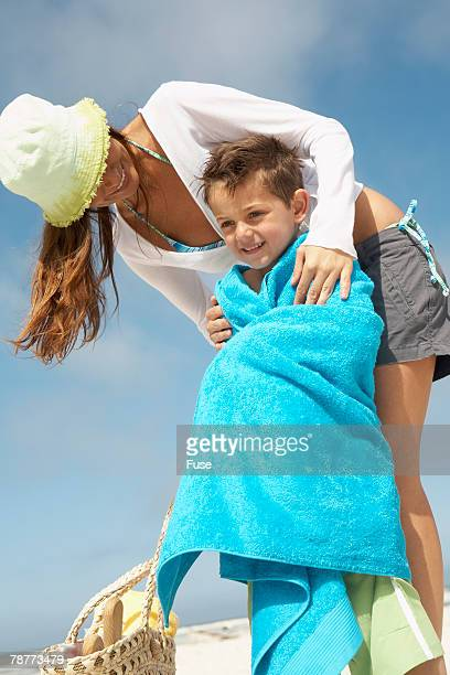 Boy Wrapped in Towel in Front of Mother