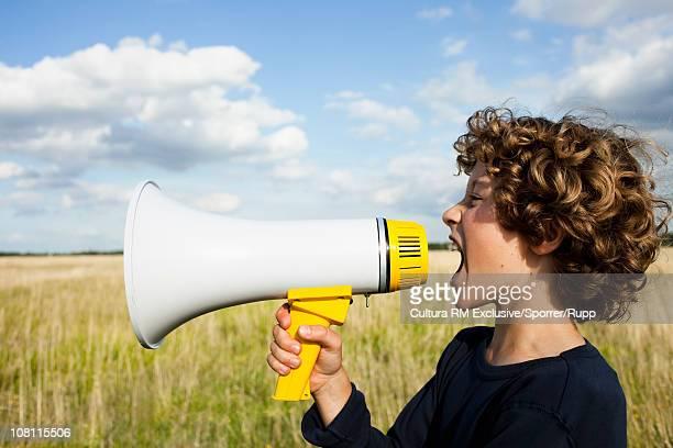 Boy yelling in megaphone