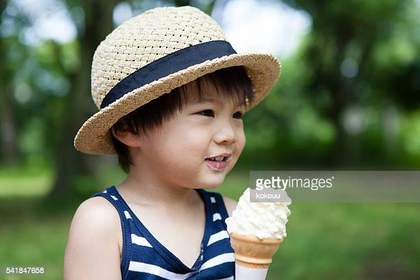 Boy you have a soft-serve ice cream in the park