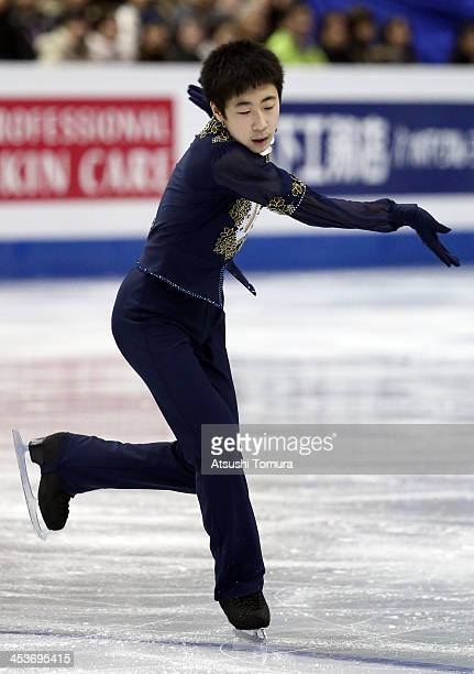 Boyang Jin of China competes in the Junior men's short program during day one of the ISU Grand Prix of Figure Skating Final 2013/2014 at Marine Messe...