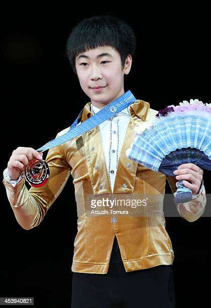 Boyang Jin of China stands on the podium after winning a gold medal in the junior men's single during day two of the ISU Grand Prix of Figure Skating...