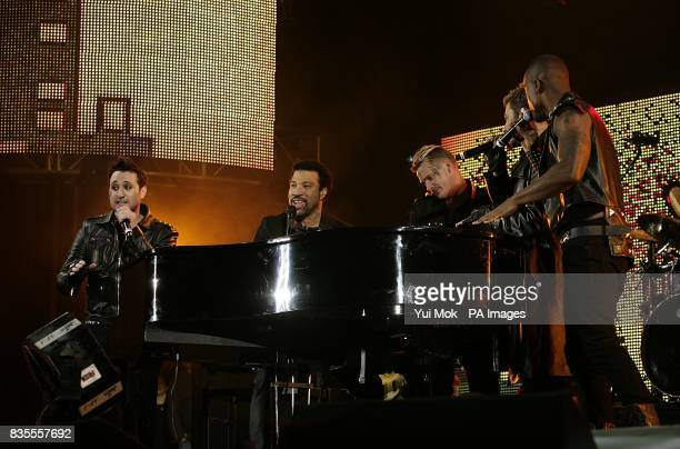Boyband Blue Anthony Costa and Lee Ryan performing on stage with Lionel Richie during the Capital 958 Summertime Ball with Barclaycard at the...
