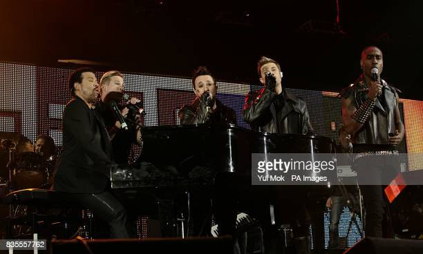 Boyband Blue Lee Ryan Anthony Costa Duncan James and Simon Webbe performing on stage with Lionel Richie during the Capital 958 Summertime Ball with...