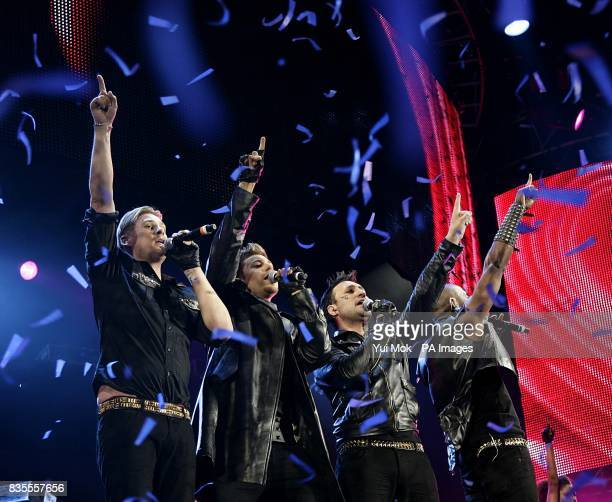 Boyband Blue Lee Ryan Duncan James Anthony Costa and Simon Webbe performing on stage during the Capital 958 Summertime Ball with Barclaycard at the...