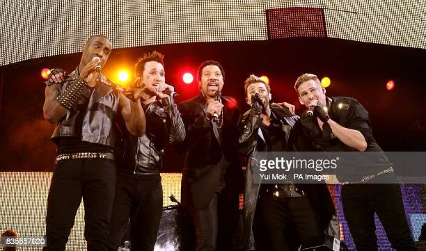 Boyband Blue Simon Webbe Anthony Costa Duncan James and Lee Ryan performing on stage with Lionel Richie during Capital 958 Summertime Ball with...