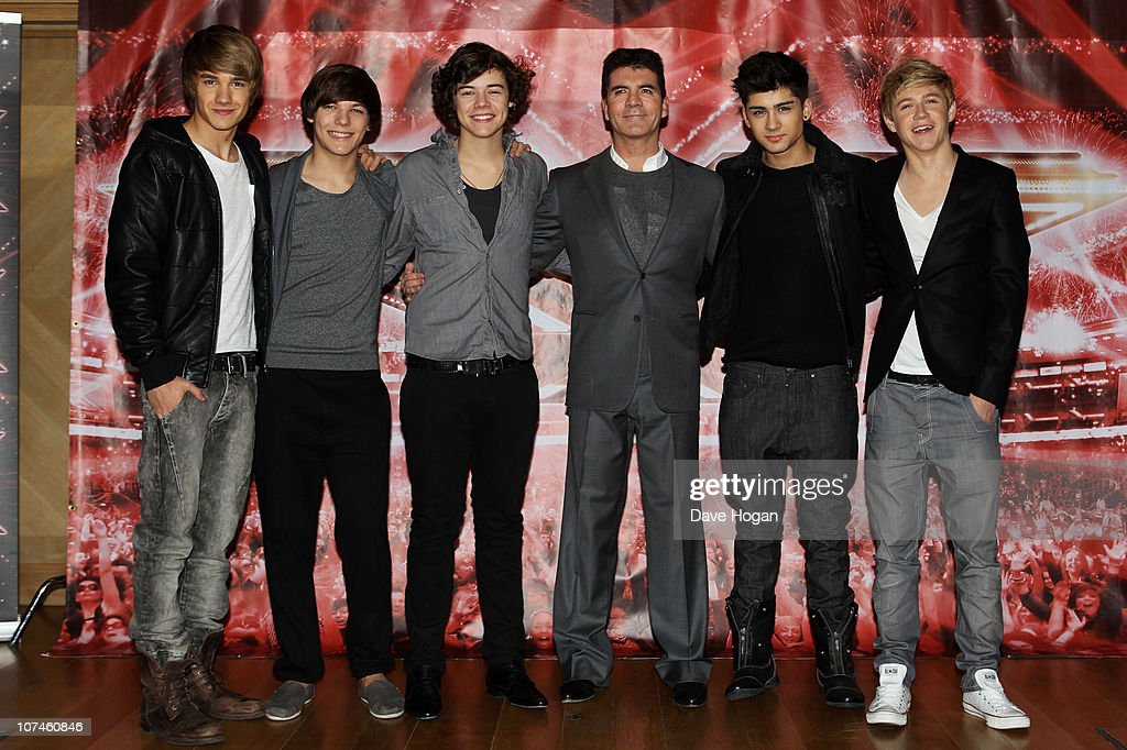 Boyband <a gi-track='captionPersonalityLinkClicked' href=/galleries/search?phrase=One+Direction+-+Boy+Band&family=editorial&specificpeople=7380629 ng-click='$event.stopPropagation()'>One Direction</a> pose with <a gi-track='captionPersonalityLinkClicked' href=/galleries/search?phrase=Simon+Cowell&family=editorial&specificpeople=203007 ng-click='$event.stopPropagation()'>Simon Cowell</a> (C) for a photocall to promote the X-Factor final held at The Connaught Hotel on December 9, 2010 in London, England.