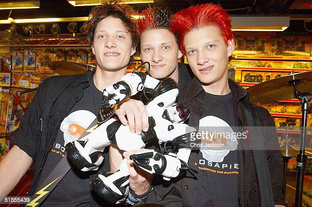 Boyband The Noise Next Door are seen with their mascot 'Robosapien' after it was announced as the winner of Hamleys Best Toy of the Year award on...