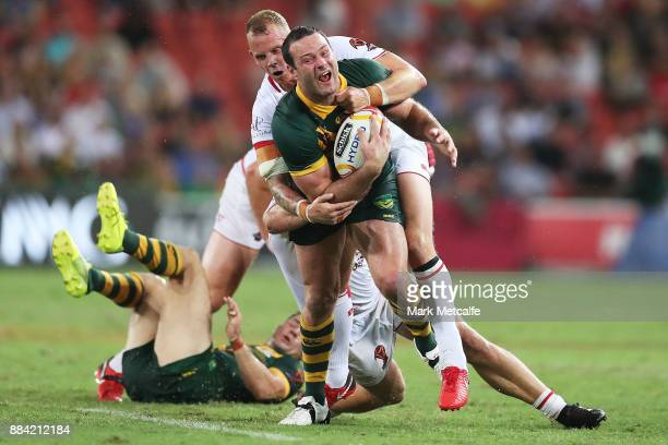 Boyd Cordner of Australia is tackled during the 2017 Rugby League World Cup Final between the Australian Kangaroos and England at Suncorp Stadium on...