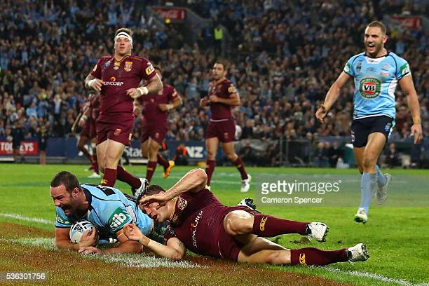 Boyd Cordner of the Blues celebrates scoring a try during game one of the State Of Origin series between the New South Wales Blues and the Queensland...