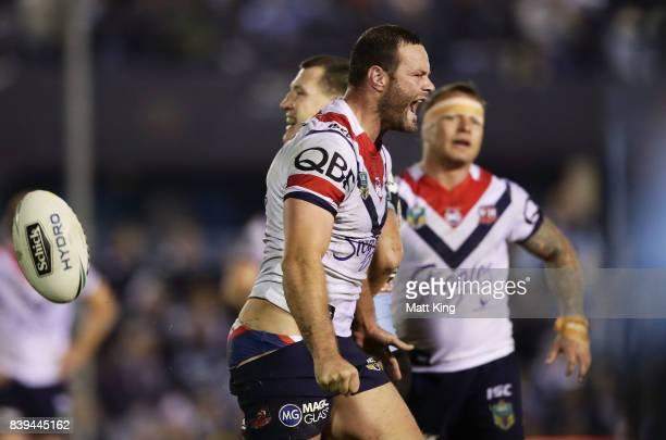 Boyd Cordner of the Roosters celebrates as Paul Gallen of the Sharks is penalised in the final minutes leading to the winning penalty goal for the...