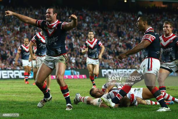 Boyd Cordner of the Roosters celebrates scoring a try during the round 8 NRL match between the St George Illawarra Dragons and the Sydney Roosters at...