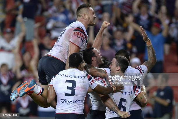 Boyd Cordner of the Roosters celebrates with team mates after scoring the match winning try during the round three NRL match between the Brisbane...