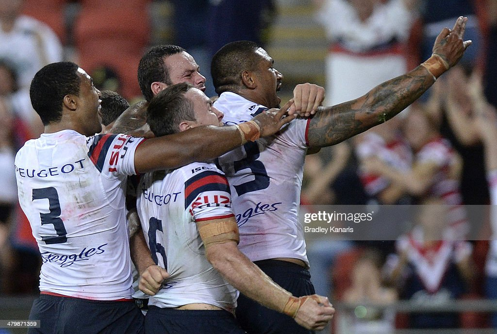 Boyd Cordner of the Roosters celebrates with team mates after scoring the match winning try during the round three NRL match between the Brisbane Broncos and the Sydney Roosters at Suncorp Stadium on March 21, 2014 in Brisbane, Australia.