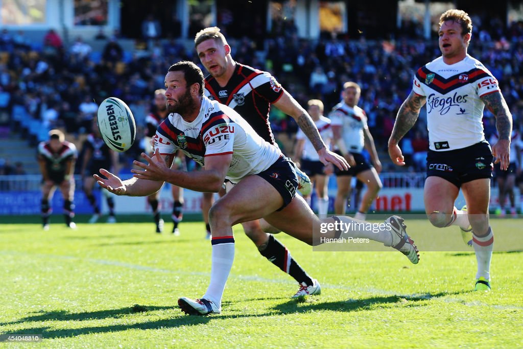 Boyd Cordner of the Roosters collects the ball to dive over and score a try during the round 24 NRL match between the New Zealand Warriors and the Sydney Roosters at Mt Smart Stadium on August 24, 2014 in Auckland, New Zealand.