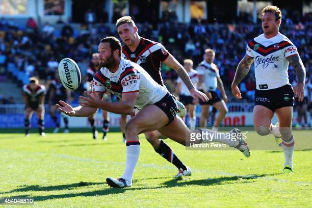 Boyd Cordner of the Roosters collects the ball to dive over and score a try during the round 24 NRL match between the New Zealand Warriors and the...