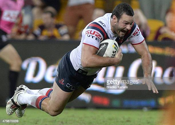 Boyd Cordner of the Roosters dives over the tryline to score the match winning try during the round three NRL match between the Brisbane Broncos and...