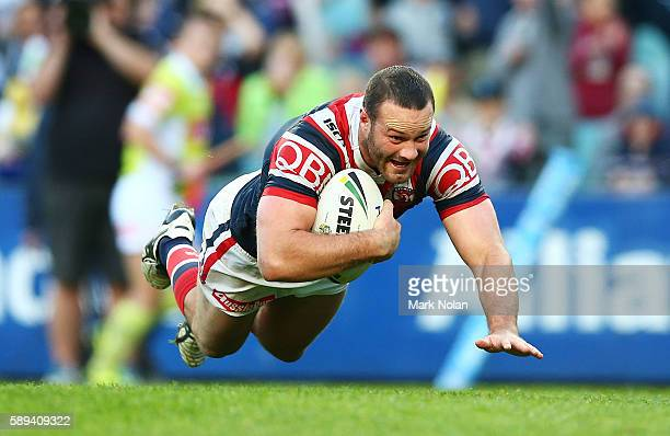 Boyd Cordner of the Roosters dives to score a try during the round 23 NRL match between the Sydney Roosters and the North Queensland Cowboys at...