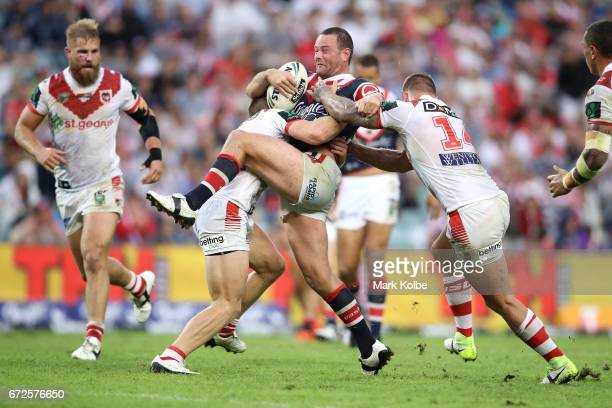 Boyd Cordner of the Roosters is tackled by Cameron McInnes and Tariq Sims of the Dragons during the round eight NRL match between the Sydney Roosters...