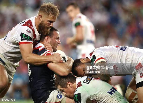 Boyd Cordner of the Roosters is tackled by Jack de Belin of the Dragons during the round eight NRL match between the Sydney Roosters and the St...